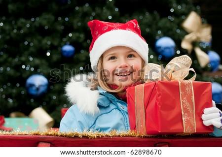 Happy little girl in Santa Claus sledge