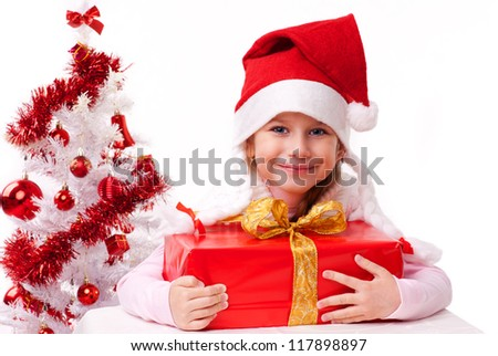Happy little girl  in santa hat,  isolated white background