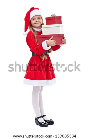 Happy little girl in santa outfit holding presents - isolated