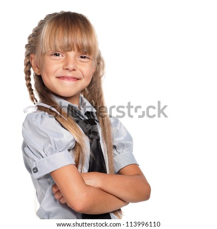 Happy little girl in school uniform isolated on white background - stock photo