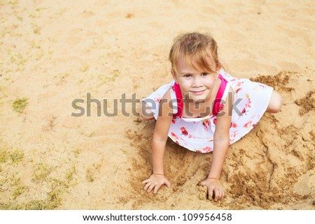 happy little girl in the sandbox