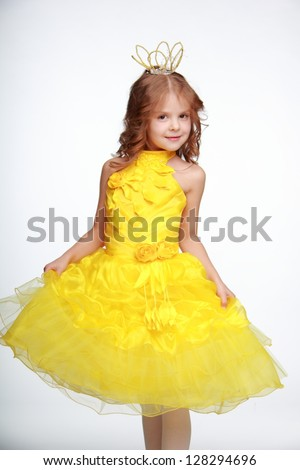 Happy Little Girl In Yellow Dress As A Princess On White ...