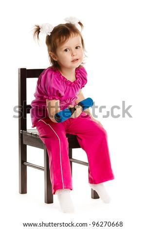 Happy little girl lifting dumbbells Isolated on white background