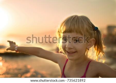 happy little girl on the seashore  #735621892