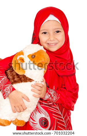 Happy little girl playing with her sheep toy - celebrating Eid ul Adha - Happy Sacrifice Feast #701032204