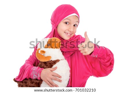 Happy little girl playing with her sheep toy - celebrating Eid ul Adha - Happy Sacrifice Feast #701032210