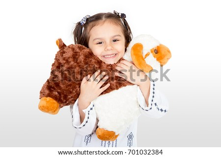 Happy little girl playing with her sheep toy - celebrating Eid ul Adha - Happy Sacrifice Feast #701032384