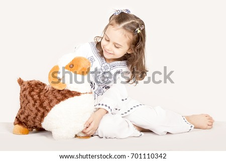 Happy little girl playing with her sheep toy - celebrating Eid ul Adha - Happy Sacrifice Feast #701110342