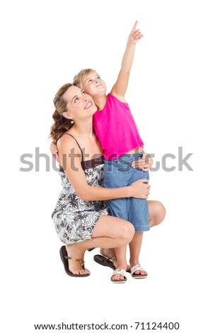 happy little girl pointing at something to her mother, isolated on white