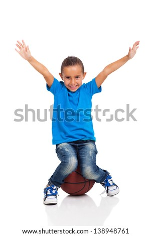 happy little girl sitting on a basketball ball on white background