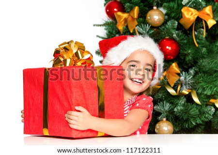 Happy little girl smiling with gift