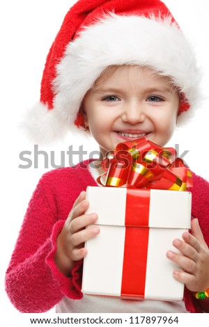 Happy little girl smiling with gift box . Christmas concept.