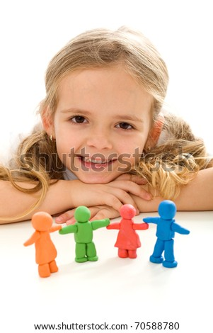 Happy little girl smiling with her colorful clay people family - isolated