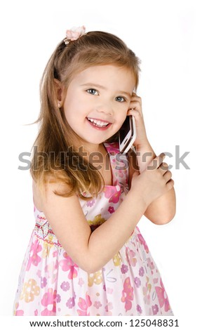 Happy little girl speaking by cell phone isolated on white