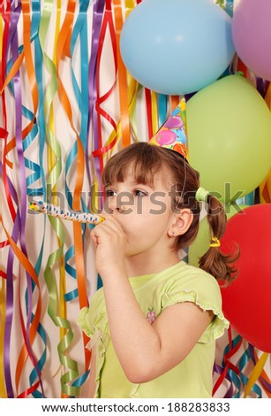 happy little girl with balloons and trumpet birthday