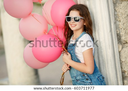 61ce18f70dfb Happy little girl with balloons summer portrait. Hipster look child girl 10  year old with