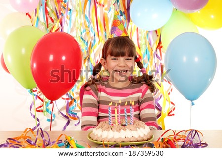 happy little girl with birthday cake