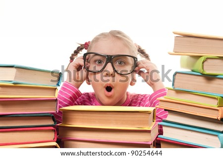 Happy little girl with books wearing black glasses, back to school concept, isolated over white