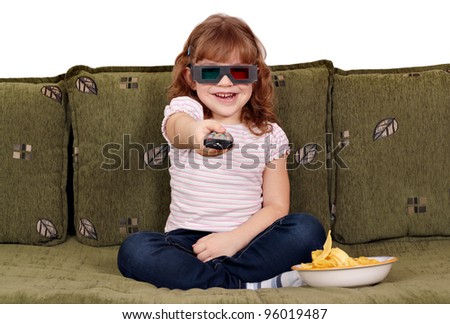 happy little girl with 3d glasses watching tv