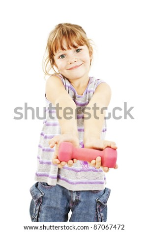Happy little girl with dumbbells. Isolated on white background
