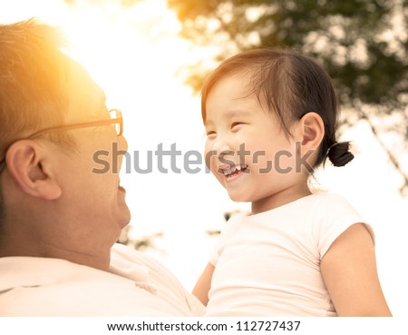 happy little girl with father