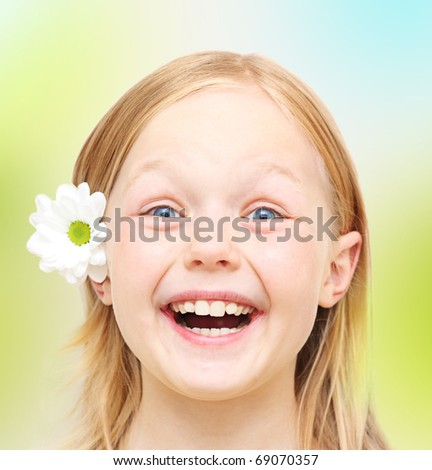 Happy little girl with flower.