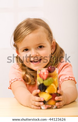 Happy little girl with fruity refreshment - healthy diet concept