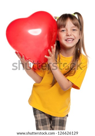 Happy little girl with red heart balloon, isolated on white background