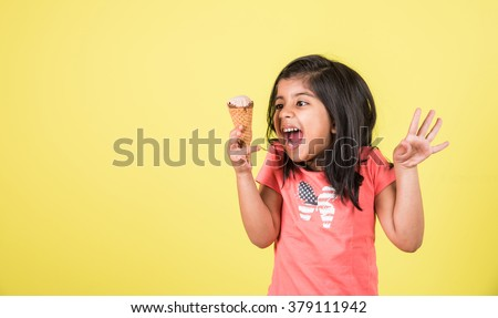 happy Little Indian girl with an ice cream cone in hand, asian girl and ice cream