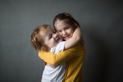 happy little kids hugging each other