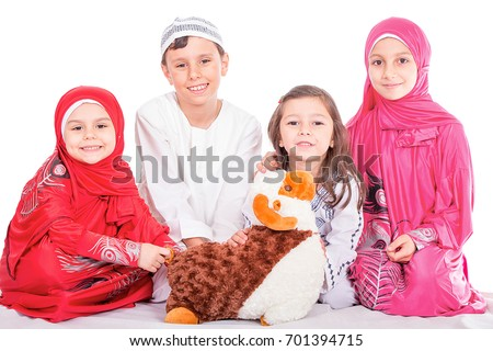 Happy little Muslim kids playing with sheep toy - celebrating Eid ul Adha - Happy Sacrifice Feast #701394715