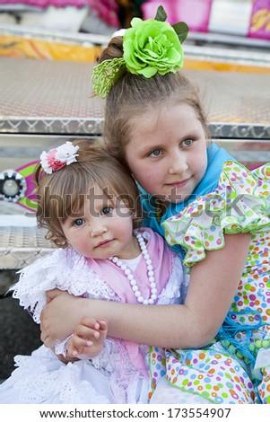 Happy little pretty girls in spanish dresses