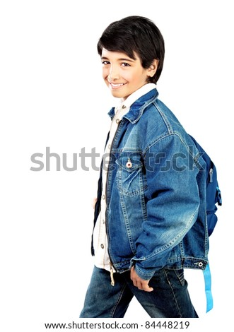 Happy little schoolboy smiling, beautiful preteen boy isolated on white background, kids back to school concept