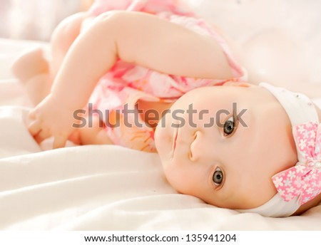 happy-looking baby  on the bed