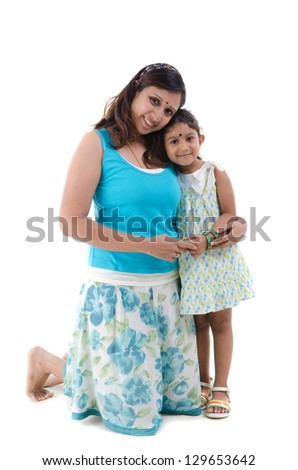 happy looking indian mother and daughter
