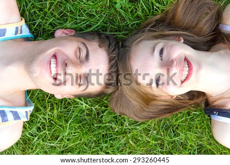 Happy love couple lying in the grass