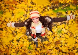 happy lovely and beautiful woman in forest in fall colors, celebrating coming autumn