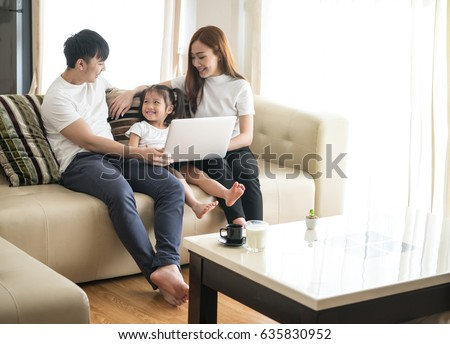 Happy loving asian family at home