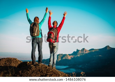 happy loving couple hiking travel in mountains #1486108076