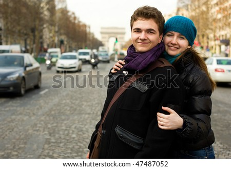 Happy loving couple in Paris on the Champs Elysees