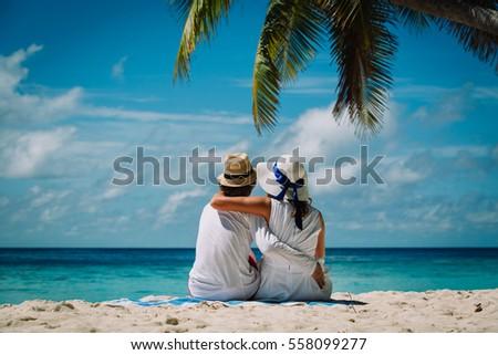 happy loving couple on tropical beach #558099277