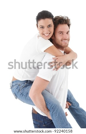 Happy loving couple smiling, hugging each other, man carrying woman pickaback.?