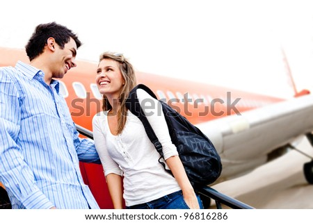 Happy loving couple traveling by airplane and smiling