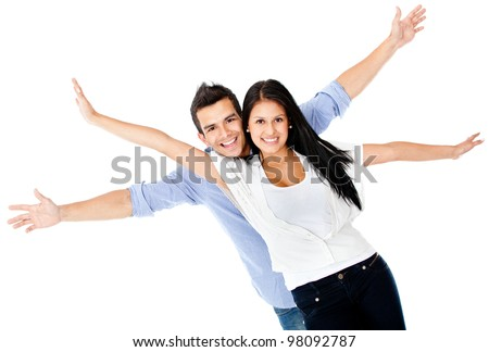 Happy loving couple with arms up - isolated over a white background