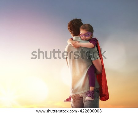 Shutterstock Happy loving family. Father and his daughter child girl playing outdoors. Daddy and his child girl in an Superhero's costumes. Concept of Father's day.