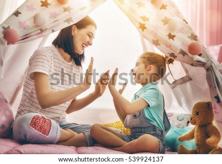 Happy loving family. Mother and her daughter girl play in children room. Funny mom and lovely child having fun indoors.  #539924137