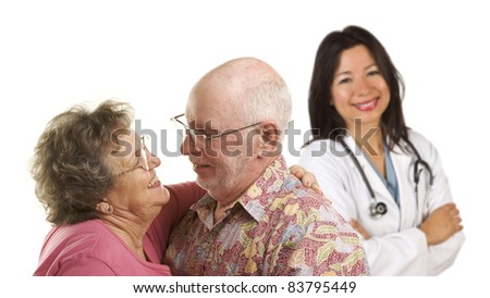 Happy Loving Senior Couple with Smiling Hispanic Medical Doctor or Nurse Behind Isolated on a White Background.