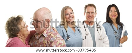 Happy Loving Senior Couple with Smiling Medical Doctors or Nurses Behind Isolated on a White Background.