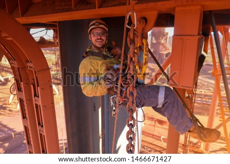 Happy maintenance inspector rope access worker rigger wearing full body industries abseiling safety harness  rising his thumb up after successfully inspecting lifting chain construction site Perth