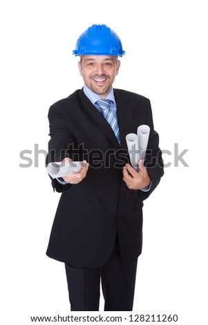 Happy Male Architect Offering Blueprint On White Background
